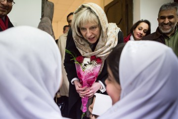 Image ©Licensed to i-Images Picture Agency. 12/02/2015. Barking, United Kingdom. Theresa May visits Al Madina Mosque. The Home Secretary Theresa May meets with students from the Young Leaders Programme, spiritual leaders, and community representatives in a visit to Al Madina Mosque in East London. Picture by Daniel Leal-Olivas / i-Images